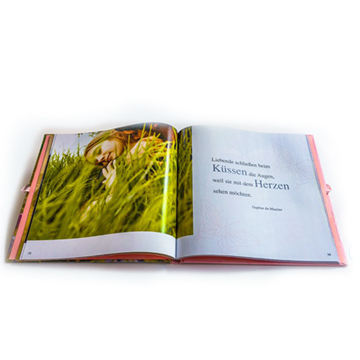 Quality assured custom hardcover art photobook with ribbon